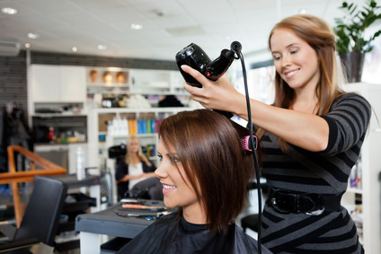 Hair Stylist Blow Drying Client